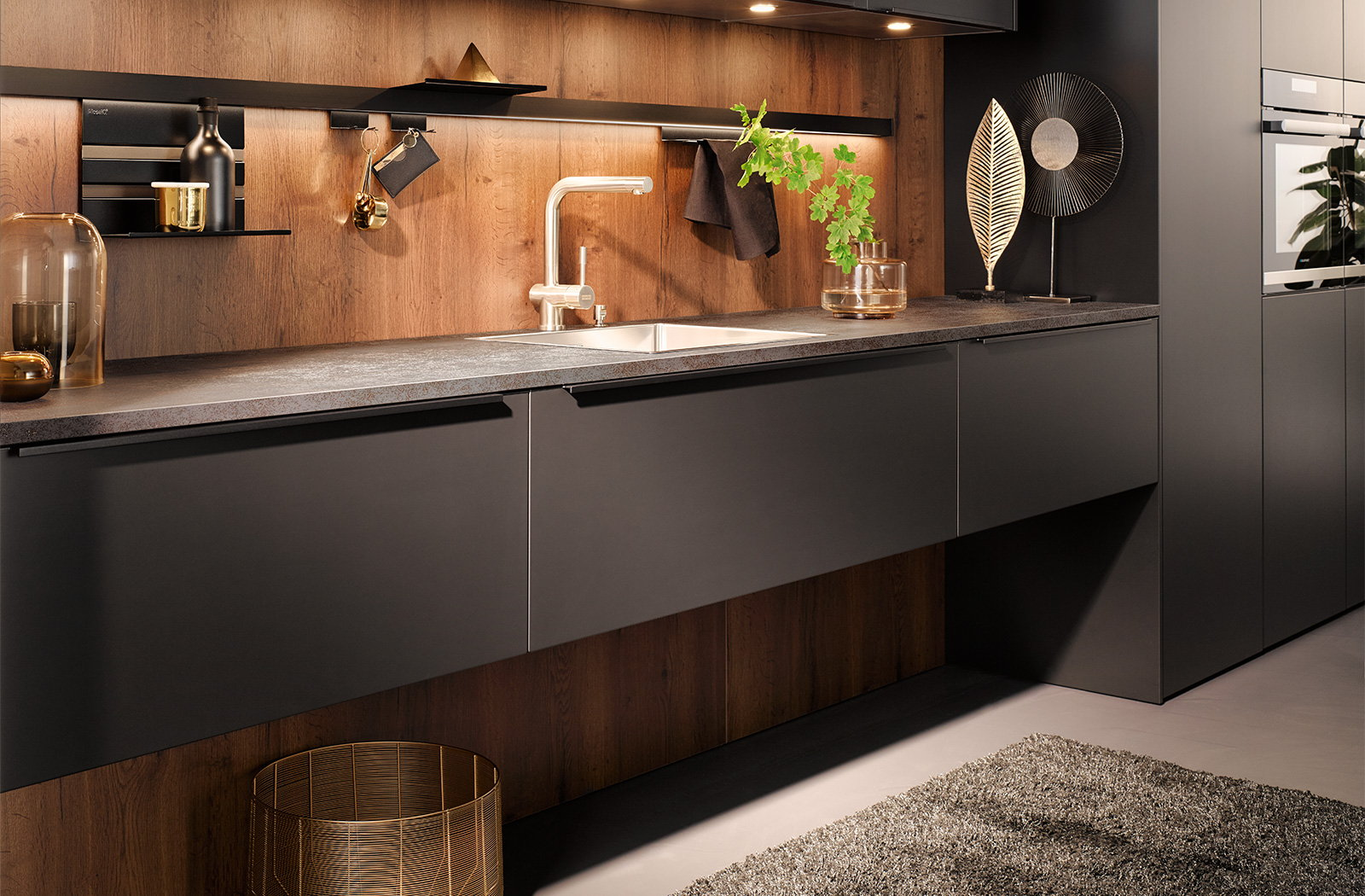 Zwarte keuken, zwarte greeplijsten als keukengrepen, Häcker design keuken AV 6000
